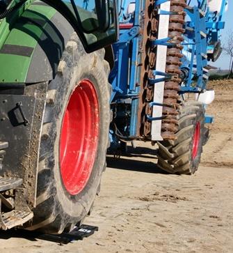 Report de charge sur l'essieu arrière du tracteur